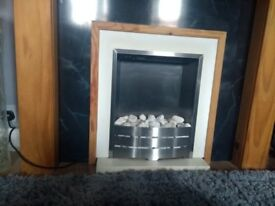 Electric fire with surround and Wooden fire place