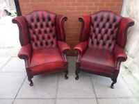 A Pair Of Oxblood Red Leather Chesterfield Queen Ann Armchairs