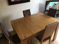 Solid oak extendable dining table with4 chairs