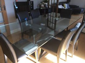 Large glass table and 6 chairs. All in good condition. Table sits 6/8 easily