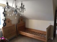 Pair of 19th-century French pine sleigh single beds