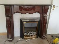 fireplace with electric fire and tile inset