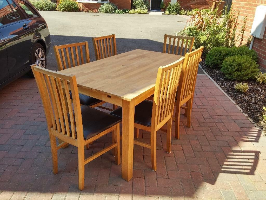 Solid Oak Extending Dining Table and 6 Chairs Black Faux  : 86 from www.gumtree.com size 1024 x 768 jpeg 150kB