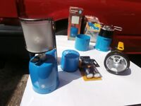 some camping equipment with 2 x new camping gas