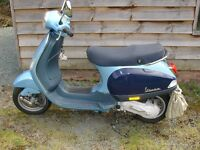 vespa lx5o scooter with cover and lock and helmet