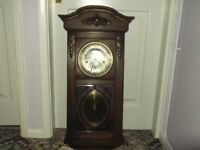 Edwardian oak wall clock with glased astragal panels