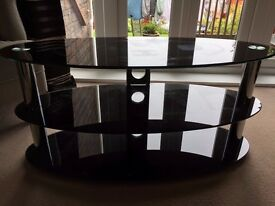 "3 Tier dark smoked glass TV stand designed to take TV's from 32"" > 55"" and up to a max 60Kg"