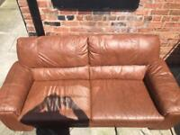 Large brown leather sofa.