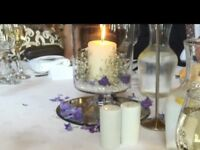 8 GLASS VASES WITH CANDLES + EXTRA OPTION OF 8 ROUND MIRROR PLATES. ONLYUSED ONCE. £50 THE LOT