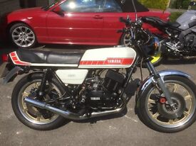 Yamaha RD400c.Red and white. Gorgeous condition. Excellent runner. Occasional dry use.Many spares.