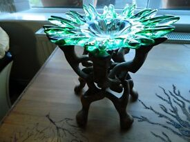 green glass and wooden stand