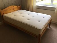 Double bed with nearly new mattress