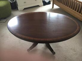 Mahogany reproduction coffee table with brass castors