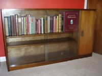 Glass fronted bookcase and cupboard