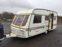 Swift Challenger 4 berth fixed bed hot and cold water 3 way fridge shower blinds fly nets oven hobs