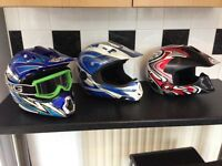 3 helmets and a body guard and a suit for kids
