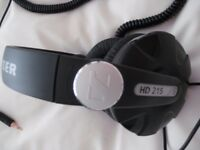 Sennheiser HD 215 Pro headphones.
