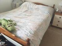 Wooden double bed and mattress