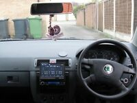 skoda fabia with dvd radio and roof bars