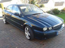 2004 jaguar x type diesel, alloys, sat nav, dvd, tv.