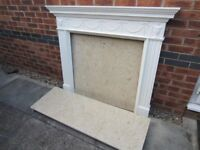Marble fireplace (including hearth and back panel) with white surround