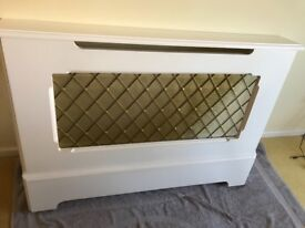 White radiator cover with brass mesh front