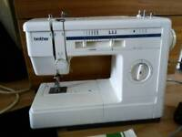 Brother electric sewing machine with instructions and accessories