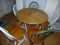 Wooden round table and 5 wooden chairs