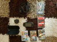 PSP playstation with 5 games, case, charger