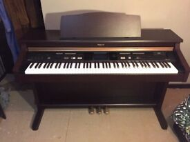 Roland KR-105 Digital Piano Keyboard with real feel keys and three pedals