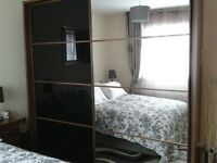 Harveys tripple wardrobe and matching kingsize bed