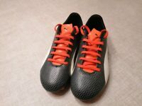 Puma football boots for kids