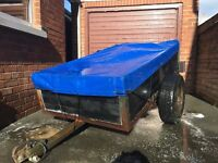 Car trailer with waterproof tarpaulin.