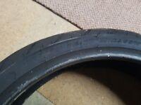 Motorbike front tyre part worn