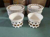 Vintage plates, saucers and sugar bowls