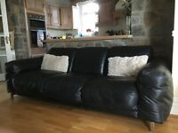 Pair of Black Leather Sofas for sale.