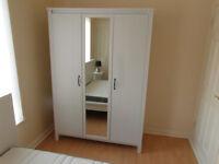 Wardrobe with mirror. IKEA BRUSALI