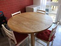 Round expanding ikea dining/kitchen table and four chairs