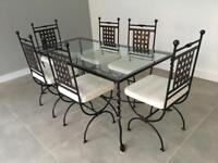 Solid wrought iron glass table and six chairs