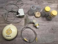 Medela swing electric breast pump and 3 bottles