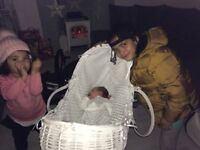 Lovely white Moses basket with rocking stand