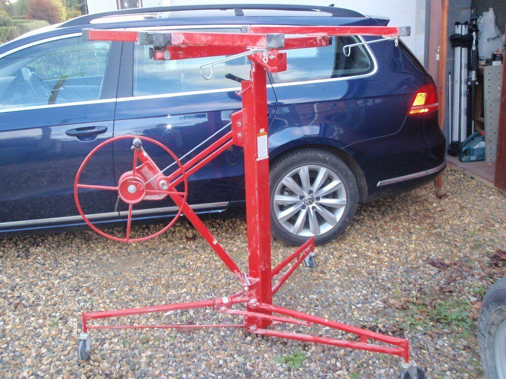 Plasterboard Lifter. Winds various size boards up to cieling height+. nearly brand new.
