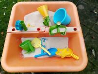 toy sand/water table with accessories