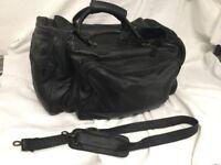 1 Arrogance black leather hand/shoulder travel bag 1980's