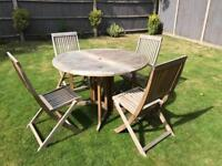 Outdoor teak garden table and chairs