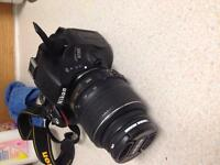 Nikon d5100 with lens and lens filter and charger and battery