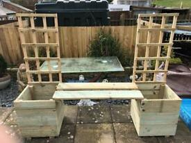 Garden bench with planters at side