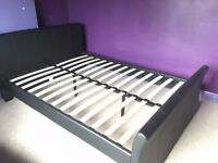 Double bed with leather effect head and foot.