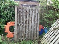 six used wood fence panels for sale.