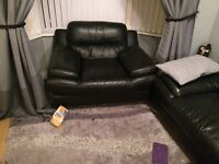 A large leather corner sofa and chair